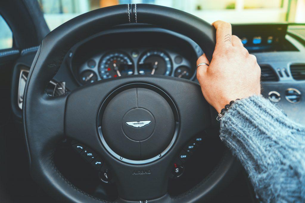 woman's hand on steering wheel